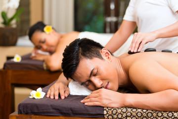 Indonesian couple having wellness massage