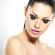 Face of the beautiful woman with fashion makeup