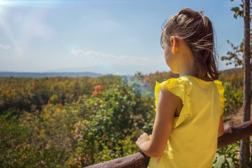Little girl looking down from viewpoint