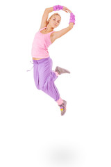 young woman in pink dress jumping