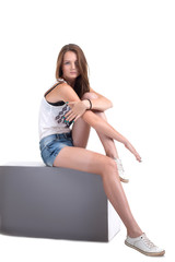Image of athletic young girl sitting on cube