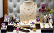 Golden jewelry with gems at showcase - 75802588