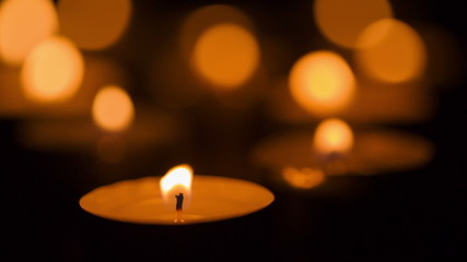 warm candles burning in the dark, shoot in raw