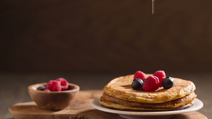 tasty homemade pancakes with berries and maple syrup, full hd