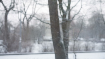 strong snow fall view from window, defocused background