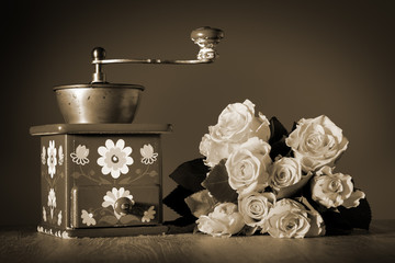 Blue coffee grinder and roses