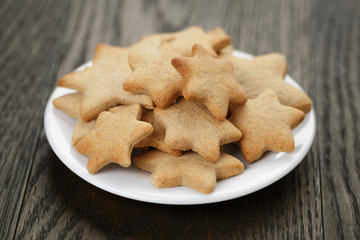 homemade star shape ginger cookies on wood table