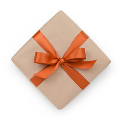 wrapped brown present box with orange ribbon bow