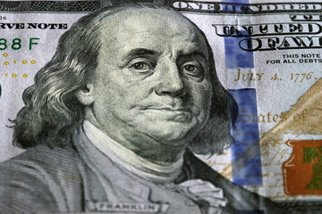 One Hundred Dollars. Selective focus on Benjamin Franklin eyes.