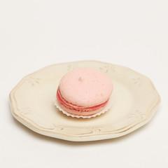 Pink macaroon on vintage plate