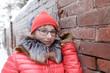 Teen next to brick wall