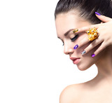 Beautiful woman with colorful nails and luxury makeup - 75808140