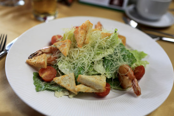 Plate of caesar salad with seafood