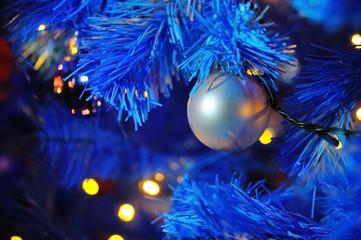 Christmas ball with garland on the tree