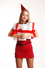 Beautiful girl holding boxes with birthday gifts