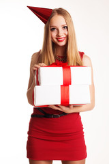Beautiful girl holding birthday gifts