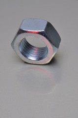 Single nut with red light reflection