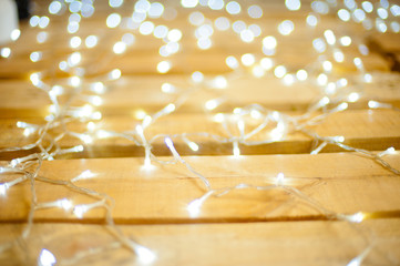 Christmas garland lights on the wooden floor