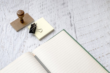 Blank notebook and stamp on paint background