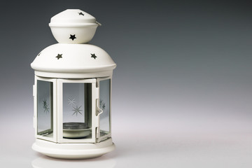 White lantern on gradient grey background