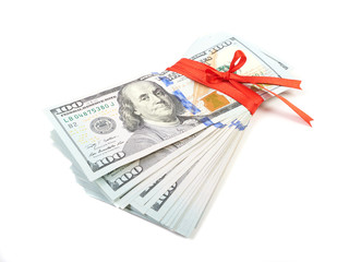 Dollar bills tied with red ribbon and decorated as a gift on a w