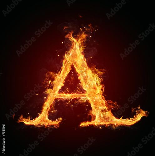 Leinwandbild Motiv Fire letter on black background