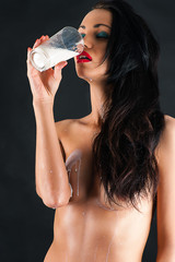 naked long haired woman drinking milk