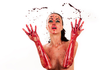 luxury woman with bloody hands and splashes of blood