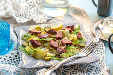 Warm salad with potatoes, pickles and chicken liver