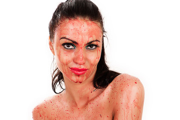 woman with a bloody face smiling