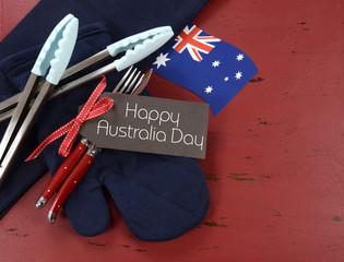 Happy Australia Day barbeque setting on red wood.