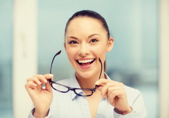 laughing businesswoman with glasses