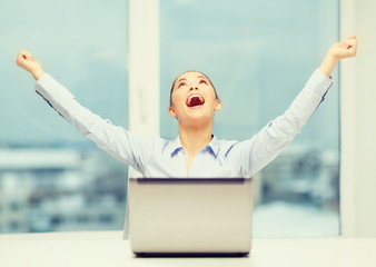screaming businesswoman with laptop in office