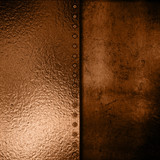 Gold metal plate on grunge background