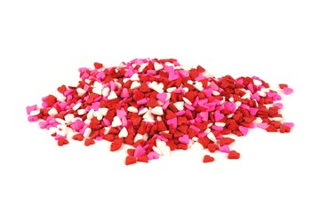 Pile of red white and pink Valentines Day candy sprinkles hearts