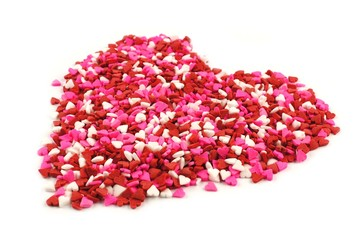 Valentines Day candy heart made of red, white and pink sprinkles