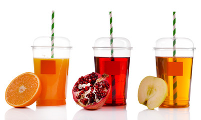 Fruit juices in fast food closed cup with tube and slices
