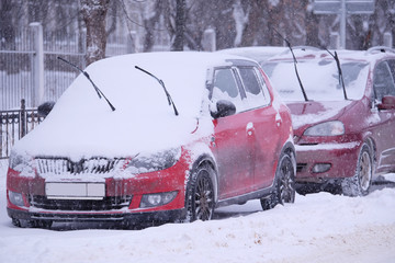 car in the parking lot under the snow