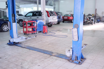 The image of lift in a car care garage