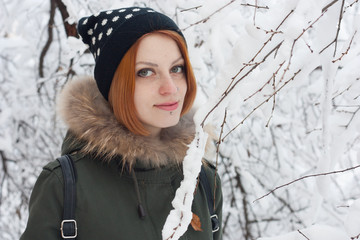 Red Hair Girl walk in snowy trees