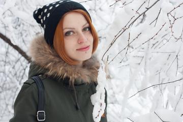 Red Hair Girl walk in snowy trees
