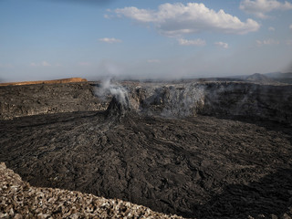 Smoking volcanic pinnacle close to Erta Ale volcano, Ethiopia