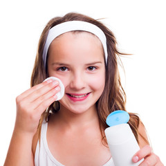 Girl cleaning her face with tonic lotion
