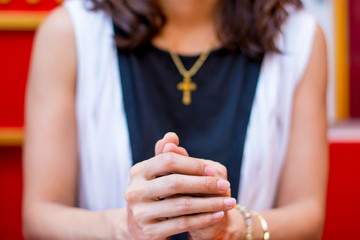 Christian Women believer praying to God  and Cross necklace