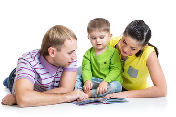 happy family with son reading children book