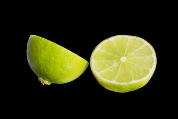 half cut of seedless lemon isolated on black