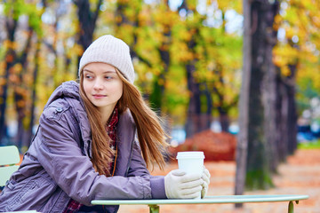 Girl drinking coffee or tea outdoors