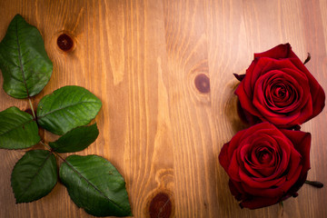 Two Valentine Roses With Leaf On Wood