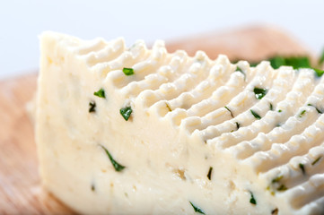 soft cheese sector with herbs close-up