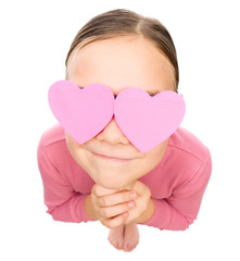 Little girl with hearts over her eyes